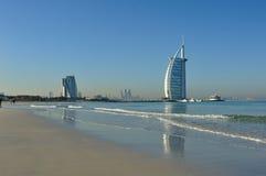 Dubai. Beach waves and hotel royalty free stock photo