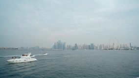 Beautiful on Dubai modern Towers and floating yachts and boats timelapse hyperlapse at night, stock video footage