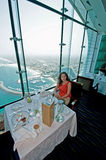 Dubai Burj Al Arab Restaurant. A lady having a meal at the restaurant at the top of the Burj al Arab Royalty Free Stock Images
