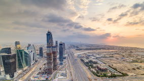 Dubai business bay towers with sunset timelapse. Rooftop view of some skyscrapers and new towers under construction. Dubai water canal with bridges and Sheikh stock footage