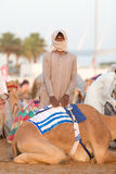 Dubai camel racing club camel and keeper. Dubai camel racing club camel and young keeper royalty free stock photography