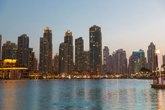 Dubai city business district and seafront at night Stock Photos