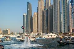 Dubai city fun water activities, Tourist attractions at Dubai Marina, UAE flag.  royalty free stock images