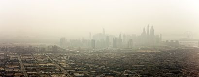 Dubai city with Marina skyline and haze. At the horizon royalty free stock images
