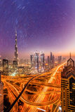 Dubai city at night under a starry sky in United Arab Emirates Royalty Free Stock Photo