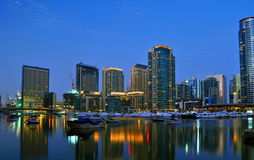 Dubai City Scape Night Scene 5. A night view of a city skyline with lights reflecting in the water stock photo