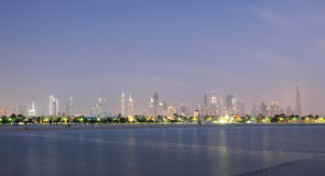Dubai City Skyline at dusk. Jumeirah Beach Park in the Foreground. United Arab Emirates Stock Image