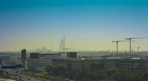 Dubai city skyline in a hot day. Aerial view royalty free stock photos