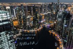 Dubai city skyline at night. Aerial view of the Dubai city skyline at night viewed from the Burj Khalifa, United Arab Emirates royalty free stock photos