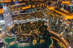 Dubai city skyline at night. Aerial view of the Dubai city skyline at night viewed from the Burj Khalifa, United Arab Emirates royalty free stock image