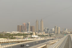 Dubai city skyline. Scenic view of Dubai city skyline viewed from the Palm with a highway in the foreground, United Arab Emirates Stock Photo