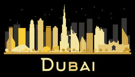 Dubai City skyline silhouette with golden skyscrapers. Stock Photo