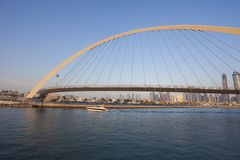 Dubai city skyline at sunset. View of Tolerance bridge royalty free stock photography