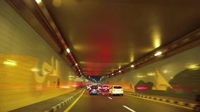 Dubai city traffic at night, United Arab Emirates. UAE, DUBAI, FEBRUARY 1, 2016: Dubai city traffic at night. Cars drives through the tunnel. Dubai is a city and stock footage