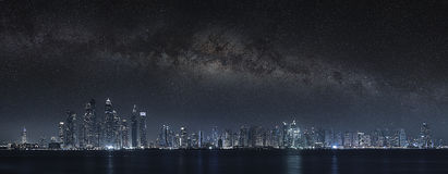 Dubai city under milky way Royalty Free Stock Images