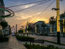 Dubai city walk streets, outdoor stores, and cafes at sunset stock photo