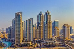 Dubai cityscape at dawn. Downtown Dubai view with construction site at dawn on January 3, 2015 in Dubai, United Arab Emirates. It is a large development complex Stock Image