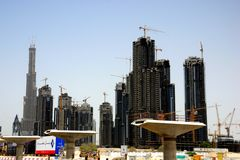 Dubai construtions & Burj Dubai. Dubai, UAE - July 2007: Dubai is a city in construction, almost 24 hours a day. Most of the cranes available in the world are stock photography
