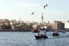 Dubai Creek - abra, boat, minaret Stock Photos