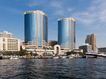 Dubai Creek with Deira Twin Towers stock image