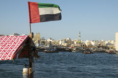 Dubai creek and dubai flag Royalty Free Stock Image