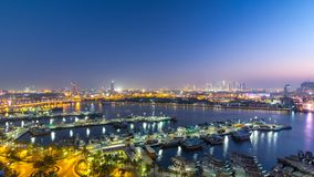 Dubai creek landscape day to night timelapse with boats and ship near waterfront. Dubai creek landscape day to night transition timelapse with boats and yachts stock video