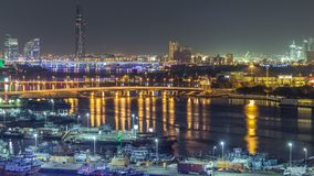 Dubai creek landscape night timelapse with boats and ship near waterfront. Dubai creek landscape night timelapse with boats and yachts and modern buildings with stock video footage