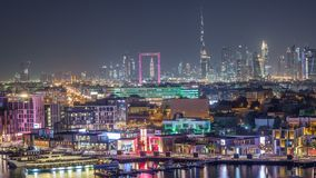 Dubai creek landscape night timelapse with boats and ship near waterfront. Dubai creek landscape night timelapse with boats and yachts and modern buildings with stock footage