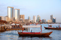 Dubai Creek view. This image was taken in Deira, Dubai. Twins Tower is one of landmark of Deira. Abbas boats is the cheapest transportation tool for crossing Royalty Free Stock Image