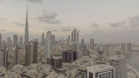 DUBAI - DECEMBER 2016: City skyline from helicopter at dusk. The. City attracts 20 million people annually Stock Photos