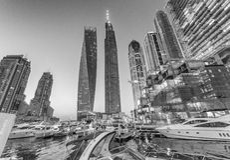 DUBAI - DECEMBER 5, 2016: Sunset in Dubai Marina. Buildings refl Stock Photography