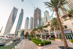 DUBAI - DECEMBER 5, 2016: Sunset in Dubai Marina. Buildings refl Royalty Free Stock Photography