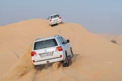 Dubai desert safari. Dune bashing in dubai desert terrain using toyota land cruiser Royalty Free Stock Images