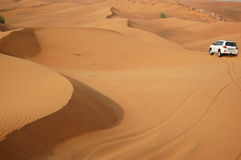 The Dubai desert trip in off-road car Royalty Free Stock Photography
