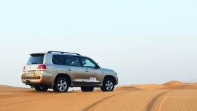 The Dubai desert trip in off-road car Royalty Free Stock Photo