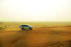 The Dubai desert trip in off-road car Stock Photography