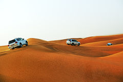 The Dubai desert trip in off-road car Royalty Free Stock Images