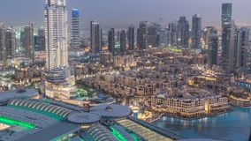 Dubai downtown day to night timelapse. Top view from above. Dubai downtown day to night transition timelapse with modern illuminated skyscrapers, mall and stock video footage