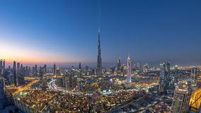 Dubai Downtown day to night timelapse view from the top in Dubai, United Arab Emirates. Dubai Downtown day to night transition timelapse with Burj Khalifa and stock footage