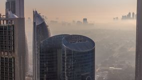 Dubai downtown during golden sunrise morning scene timelapse. Aerial top view from above with fog and Dubai creek harbor buildings on background stock video footage