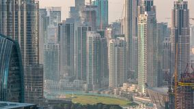 Dubai downtown during golden sunrise morning scene timelapse. Aerial top view from above with park and green lawn stock footage