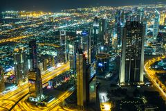 Dubai downtown night scene with city lights, Stock Images