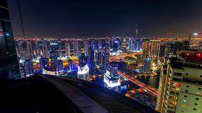Dubai downtown night to day transition timelapse with modern skyscrapers, mall and traffic on the road before sunrise. Top view stock image