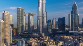 Dubai Downtown skyline during sunrise timelapse with Burj Khalifa and other towers paniramic view from the top in Dubai. United Arab Emirates. Sun reflected stock footage