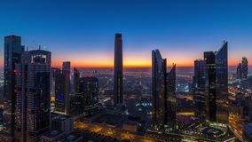 Dubai downtown skyline with tallest skyscrapers and traffic on highway night to day timelapse. Dubai downtown skyline with tallest skyscrapers in financial stock video footage