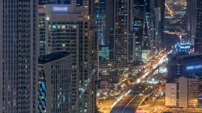 Dubai Downtown night timelapse modern towers view from the top in Dubai, United Arab Emirates. Dubai Downtown skyscrapers night timelapse modern towers view stock footage
