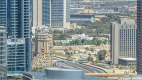 Dubai downtown at sunny day timelapse. Luxury modern buildings with traffic on the road, futuristic cityscape of United Arab Emirates. Aerial top view from stock video