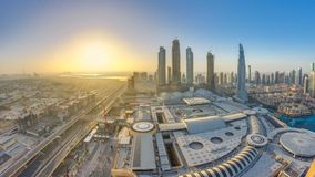 Dubai downtown with sunrise timelapse. Top view from above. Dubai downtown with sunrise timelapse with modern skyscrapers, mall and traffic on the road at the stock video footage