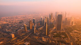 Dubai Downtown sunrise timelapse view from the top in Dubai. Dubai Downtown sunrise view from the top in Dubai, United Arab Emirates stock footage