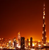 Dubai downtown on sunset. Dubai downtown sunset scene with city lights, luxury new high tech town in middle East, United Arab Emirates architecture Stock Photo
